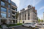 zwei Mehrfamilienhäuser mit Gewerbe